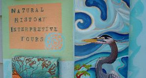 Hand painted sign of blue heron advertising guided interpretative kayak tours. Art work by Hilary Masson